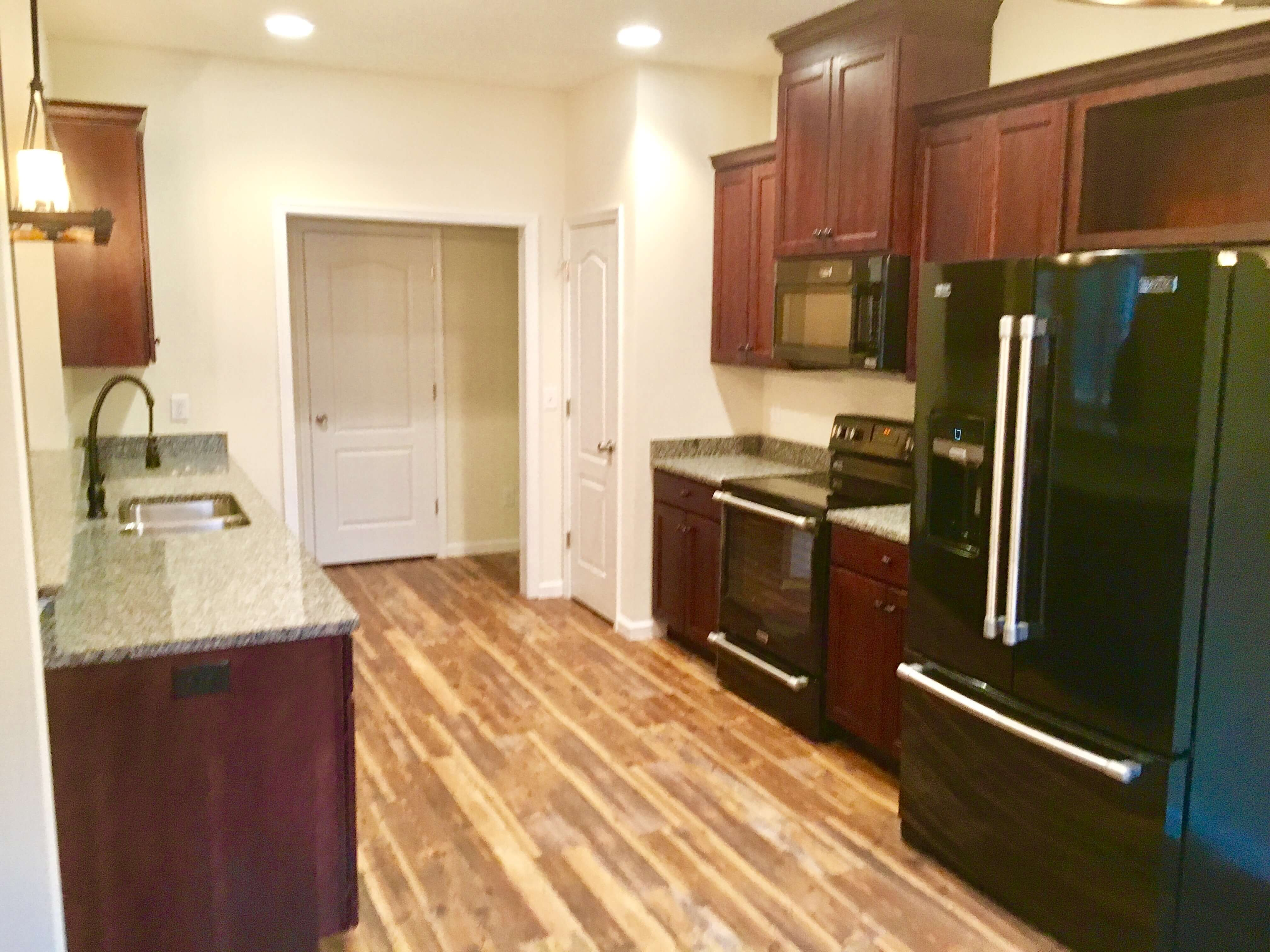 Kitchen with wood cabinets wood floors