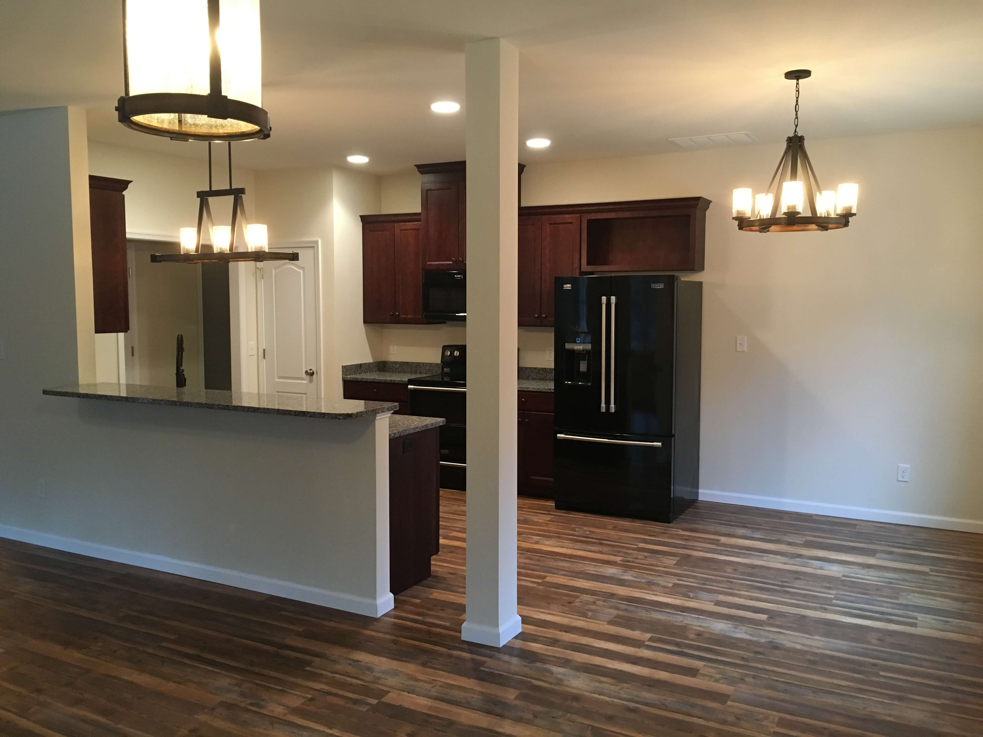 kitchen wood floors column and chandelier